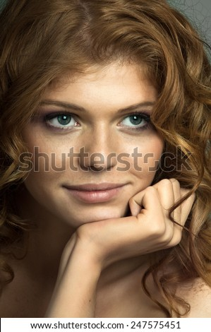 the very  pretty red-haired young woman,  sensual  captivating look ,vertical portrait - stock photo