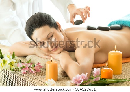 the very  pretty  young woman on spa treatment , horizontal  portrait