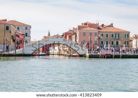The Vico's bridge in Chioggia, Italy, seen from the Venetian lagoon. The famous bridge, the destination of many tourists, was built in 1685. - stock photo