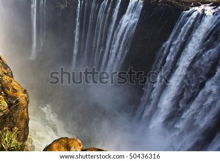 The Victoria Falls at the border of Zimbabwe and Zambia - stock photo