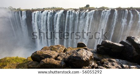 The Victoria Falls at the border of Zimbabwe and Zambia - stock photo