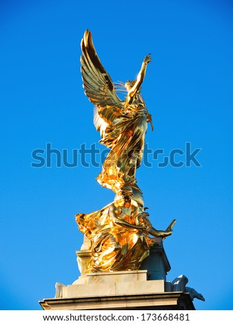 The Victoria Memorial is a sculpture dedicated to Queen Victoria, sculpted by Sir Thomas Brock in London, placed at the center of Queen's Gardens in front of Buckingham Palace. - stock photo
