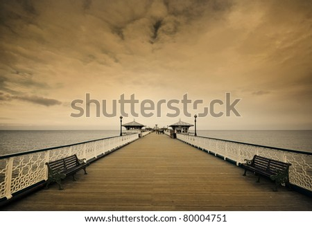 the victorian pier at llandudno, north wales, uk. Toned image to give a vintage appearance - stock photo