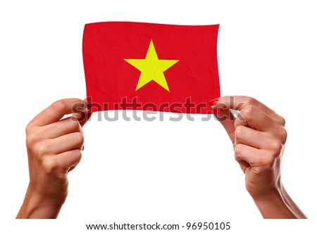 The Vietnamese flag in the woman hands. closeup - stock photo