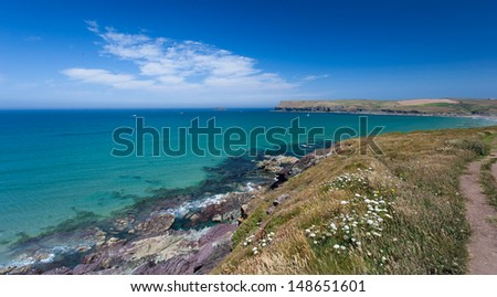 The view across Polzeath towards Pentire Point, North Cornwall - stock photo