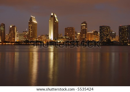 The view at downtown San Diego at dusk from Coronado island marina. - stock photo