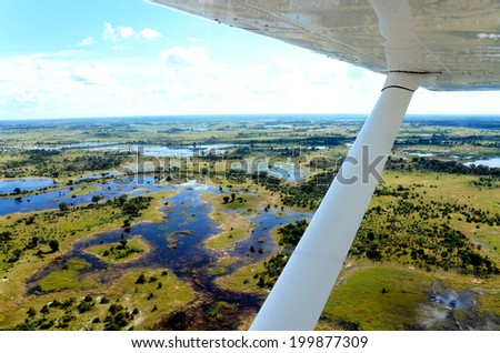 the view from an aircraft flying over the Okavango delta in africa - stock photo