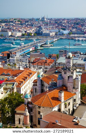 The view from Galata Tower to Galata Bridge which is connected Beyoglu region and Sultanahmet on the opposite shores of Golden Horn, Istanbul, Turkey - stock photo
