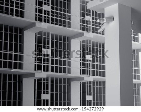 The view from the inside of a brick jail cell with iron bars. - stock photo