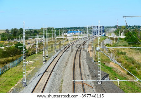 The view from the pedestrian bridge near the station Bogolubovo on railway tracks and the bridge over the River Nerl - stock photo