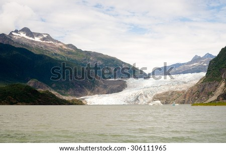 The view from the shore of Mendenhall Lake at ice that persists in the summer - stock photo