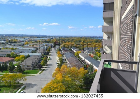 The view from the 15th floor of an condominium high rise building of the surrounding single homes area. - stock photo