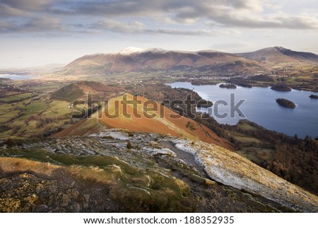 The view north from the summit of Catbells in the English Lake District, bathed in early morning winter sunshine. - stock photo