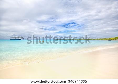 The view of a beach  on uninhabited island Half Moon Cay (The Bahamas). - stock photo
