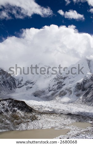 The view of a cloud covered Everest from the top of Kala Patthar. - stock photo