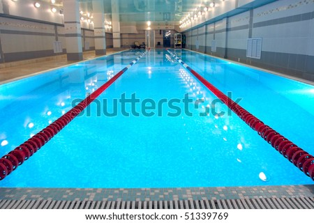 the view of a swimming pool indoors - stock photo