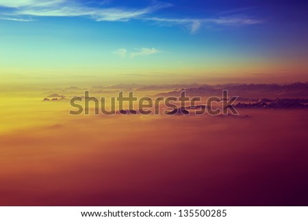 The view of Alps mountains from the plane. - stock photo