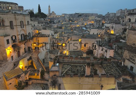 The view of Ancient town of Matera (Sassi di Matera) during blue hour. Basilicata, southern Italy. European Capital of Culture for 2019. UNESCO World Heritage. - stock photo