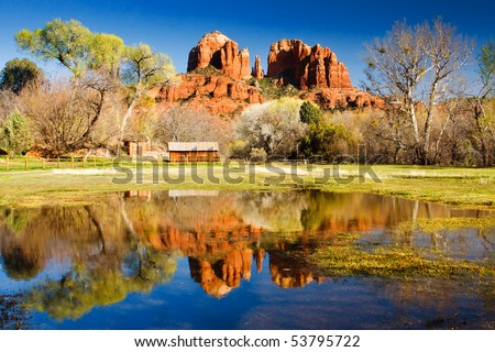 The view of Cathedral Rock in Sedona, Arizona.  The towering rock formations stand out like beacons in the dimmed landscape of the Red Rock State Park. - stock photo