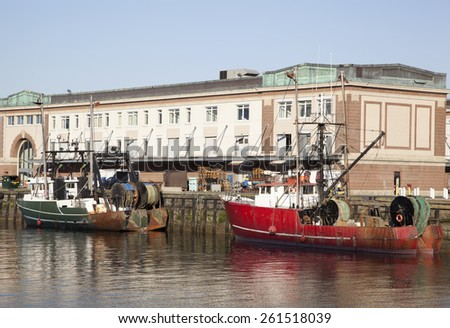 The view of colorful fishing boats in the city of Boston (Massachusetts).