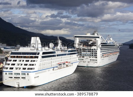 The view of cruise liners docked in Ketchikan with evening sky in a background (Alaska). - stock photo