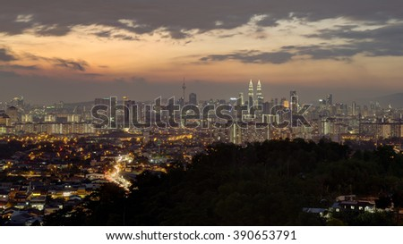 The view of Kuala Lumpur city from a distance during sunset hour.