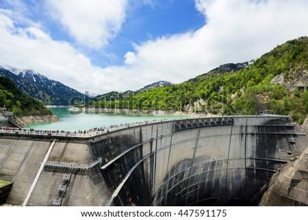 The view of Kurobe Dam. The Kurobe Dam or Kuroyon Dam is a variable-radius arch dam on the Kurobe River in Toyama Prefecture, Japan. - stock photo