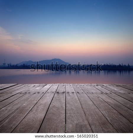 The view of lake with sunset - stock photo