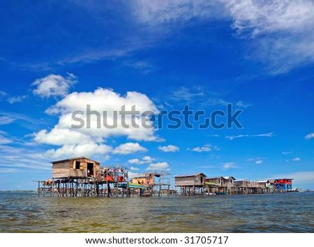 The view of Malaysia Borneo Region of Sabah Mabul Semporna island Fisherman sea-gypsies houses - stock photo