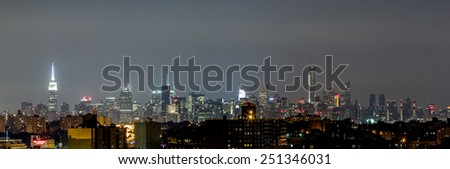 The view of Manhattan skyline at night from Queens, New York