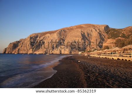 The view of Mesa Vouna Mountain from Kamari Beach in morning.