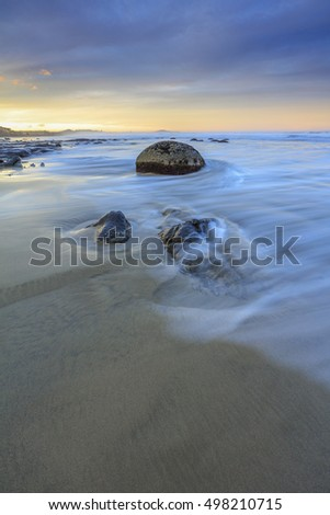 The view of Moeraki Boulders beach, during sunrise at South Island, New Zealand