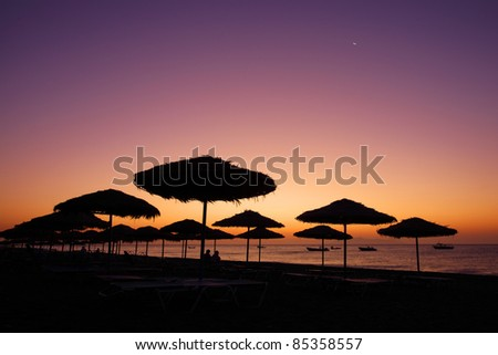 The view of sunrise at Kamari Beach in Santorini Island, Greece. - stock photo