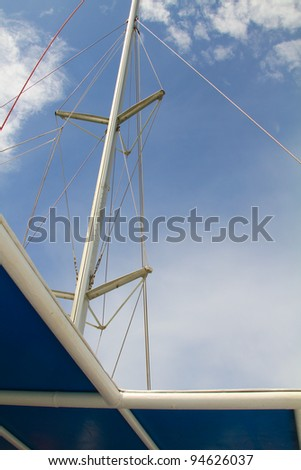 The view of the boat mast from lower deck