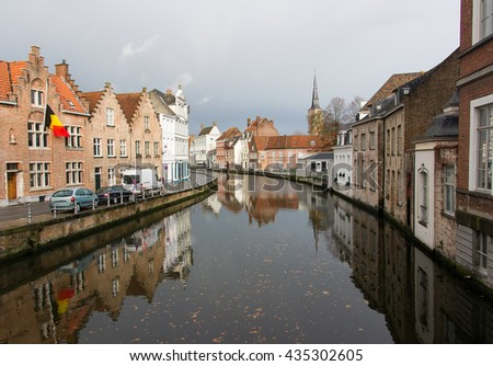 The view  of the canals and the historic quarter of Bruges cloudy autumn morning. Bruges. Belgium is one of the oldest and most beautiful cities in Europe. - stock photo