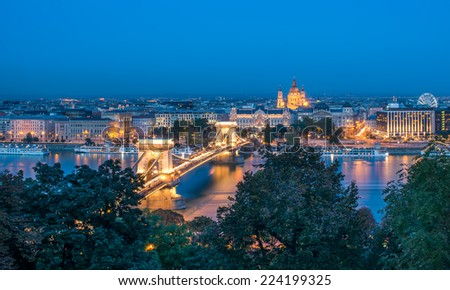The view of the Chain bridge, Saint Istvan's basilica and the Danube in Budapest from the Buda castle area in the evening lights - stock photo