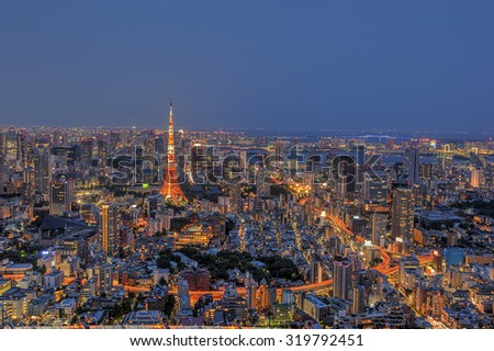 The view of Tokyo Tower and surrounding buildings during late evening from Mori Tower, Roppongi, Tokyo.