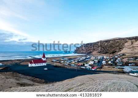 The view of Vik's church and city, Iceland and the famous black sand beach. - stock photo