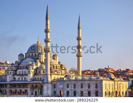 The view of Yeni Cami (New Mosque) originally named the Valide Sultan Mosque (Valide Sultan Camii) from Galata Bridge, Istanbul, Turkey - stock photo