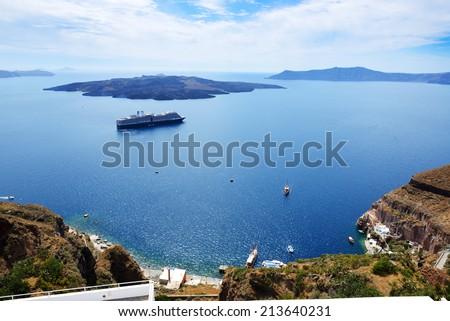 The view on Aegean sea and cruise ship, Santorini island, Greece - stock photo