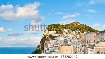 The view on houses and villas of Capri island with a Gulf of Naples and Vesuvius mountain on a background, Italy. - stock photo