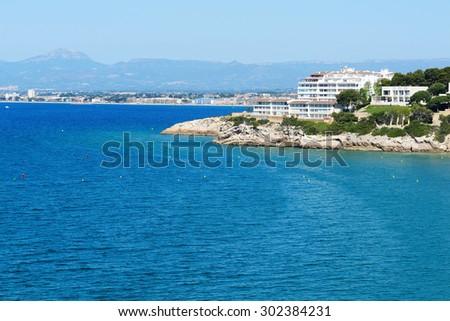 The view on luxury hotel and bay, Costa Dorada, Spain - stock photo