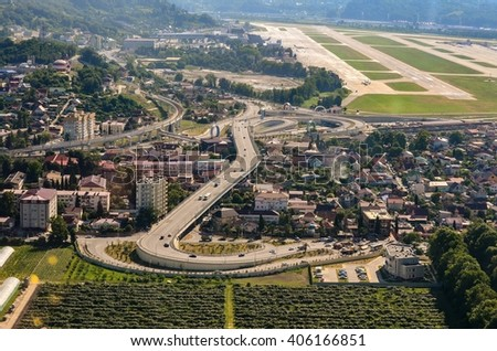 The view on road from sky. The road is in resort city. - stock photo