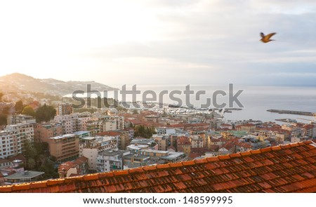 the view on Sanremo in the morning haze, Italy - stock photo