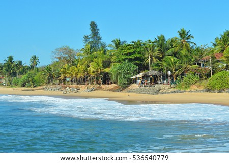 The view on the beach of the island of Ceylon in the Indian ocean