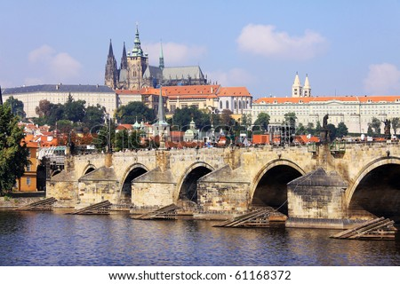The View on the summer Prague gothic Castle with the Charles Bridge - stock photo
