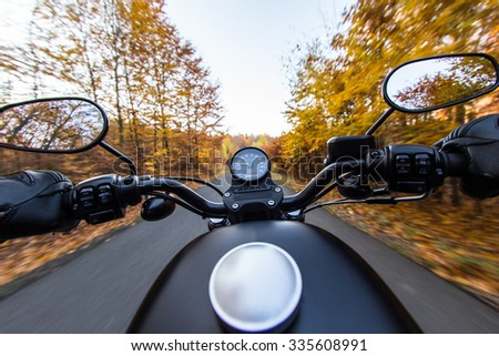 The view over the handlebars of motorcycle - stock photo