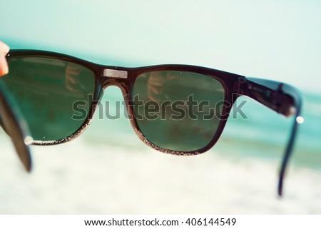 The view through the sunglasses beautiful seascape - stock photo
