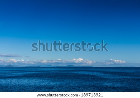 The view with blue sky from the cruise in Alaska - stock photo