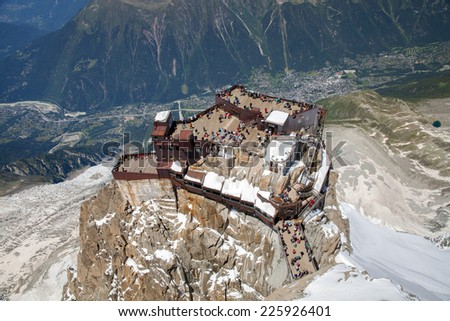 The viewing point on Aiguille du Midi peak against chamonix valley in summer time - stock photo